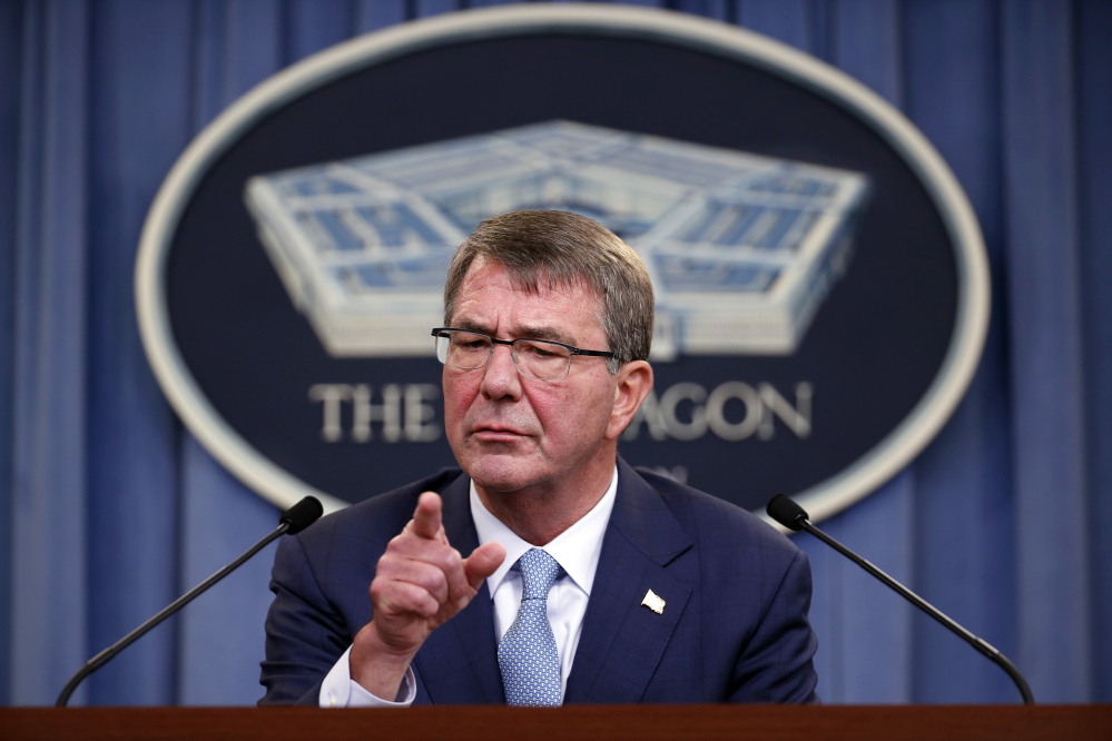 Defense Secretary Ashton Carter takes a question at a news conference at the Pentagon on Thursday while announcing new rules allowing transgender people to serve openly in the U.S. military.