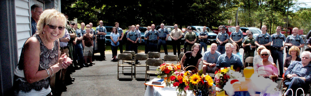 Becky Berry, administrative assistant to the Maine State Police Troop C commander, speaks at her retirement party Thursday in Skowhegan. She was honored for 36 years of service.