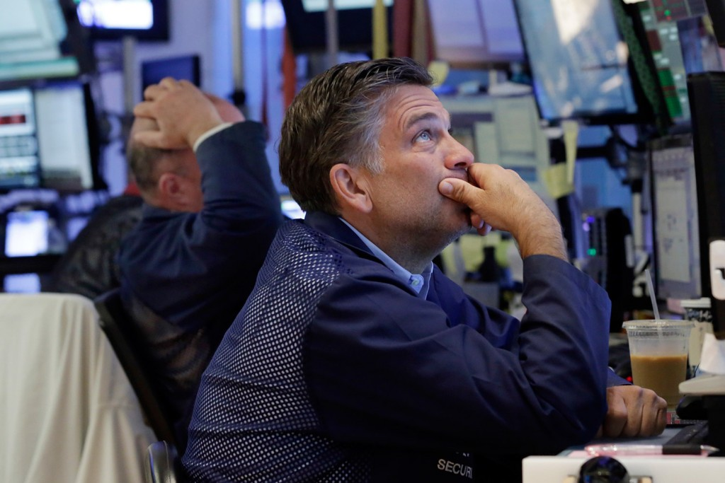 Trader Jeffrey Lucchesi works on the floor of the New York Stock Exchange Monday. Stocks are opening lower on Wall Street following bigger losses in Europe as investors continue to grapple with the fallout of Britain's vote to leave the European Union.