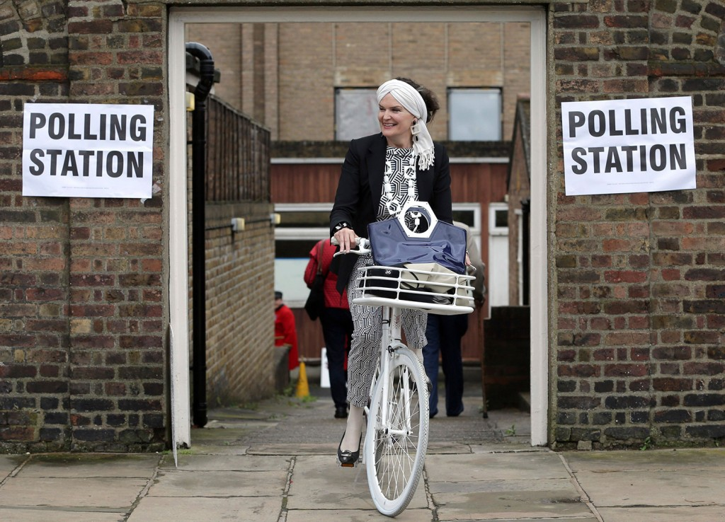 A woman on a bicycle leaves a polling station near to the Royal Chelsea Hospital in London. Voters in Britain are deciding whether the country should remain in the European Union.