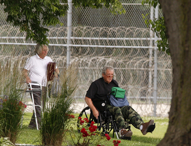 Former Speaker of the House Dennis Hastert, right, reports to the Federal Medical Center in Rochester, Minn.
