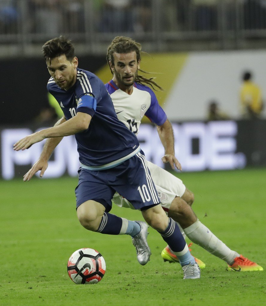 Lionel Messi gets the ball past U.S. midfielder Kyle Beckerman as Argentina was a step ahead of the Americans most of the night.   Associated Press/David J. Phillips