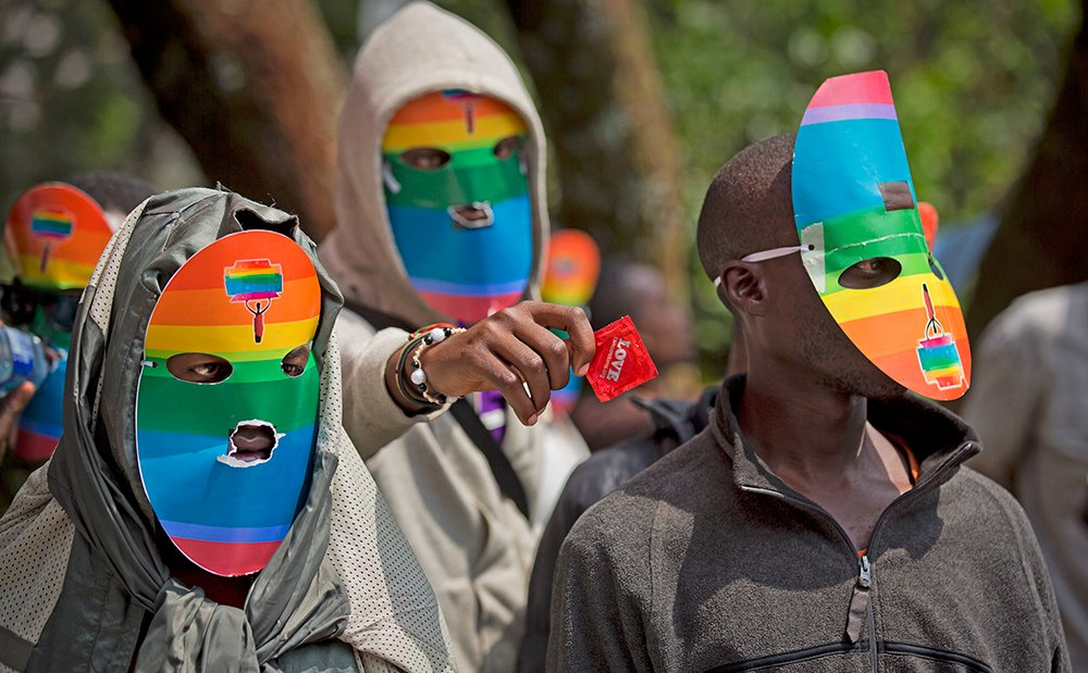 Kenyan gay men,  lesbians and others wear masks to preserve their anonymity as they protest in February 2014 against Uganda's increasingly tough stance forbidding homosexuality. In the current case, two men accused of engaging in gay sex could face 14 years in jail if convicted. Associated Press