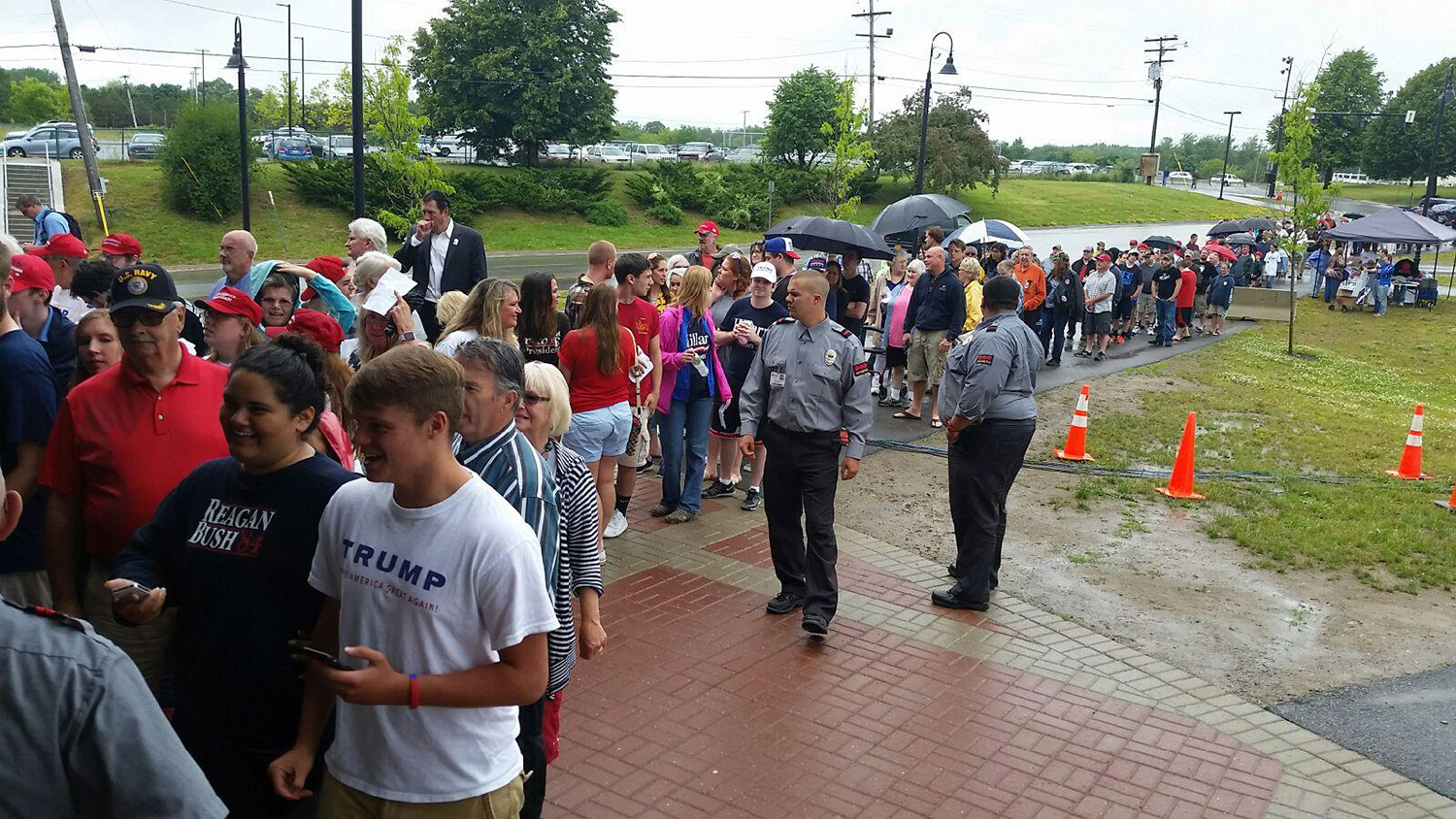 People line up in the rain early Wednesday afternoon to see Donald Trump at a 4 p.m. rally at the Cross Insurance Center in Bangor.