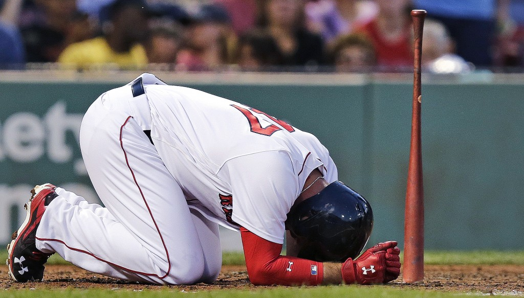 Boston's Travis Shaw kneels at home plate after getting hit with a foul tip during the fourth inning Tuesday. White Sox pitcher Chris Sale struck out nine Red Sox players as Chicago picked up a 3-1 win.    Associated Press/Charles Krupa