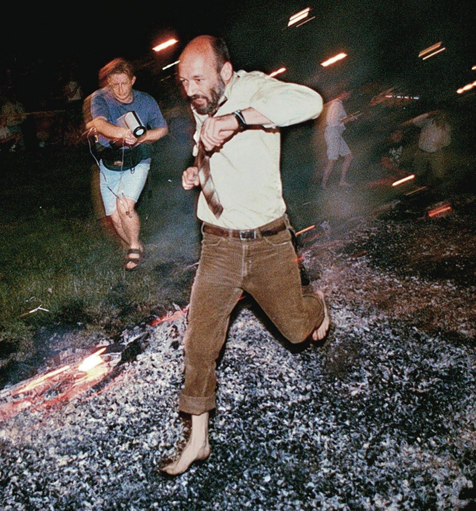 A walk over hot coals, like the one above, left more than 30 people injured at a Tony Robbins event. The Associated Press