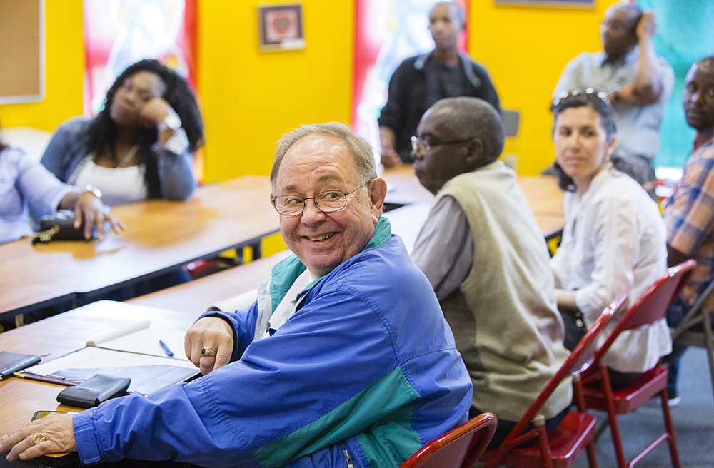 "Georges Blouin of Lewiston shares a smile with other members of the Hillview Adult French Club. ""I come to really speak French, because it gives me an avenue to continue speaking my native language,"" he says."