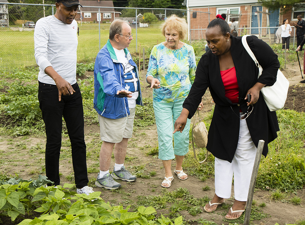 Group leader Blandine Injonge, right, an immigrant of four years from the Democratic Republic of the Congo, shares the community garden with members of the Hillview Adult French Club. Members are, from left, Serge Betu Muambi from the the Congo, Georges Blouin of Lewiston and Jacqueline Webb of Poland Springs.