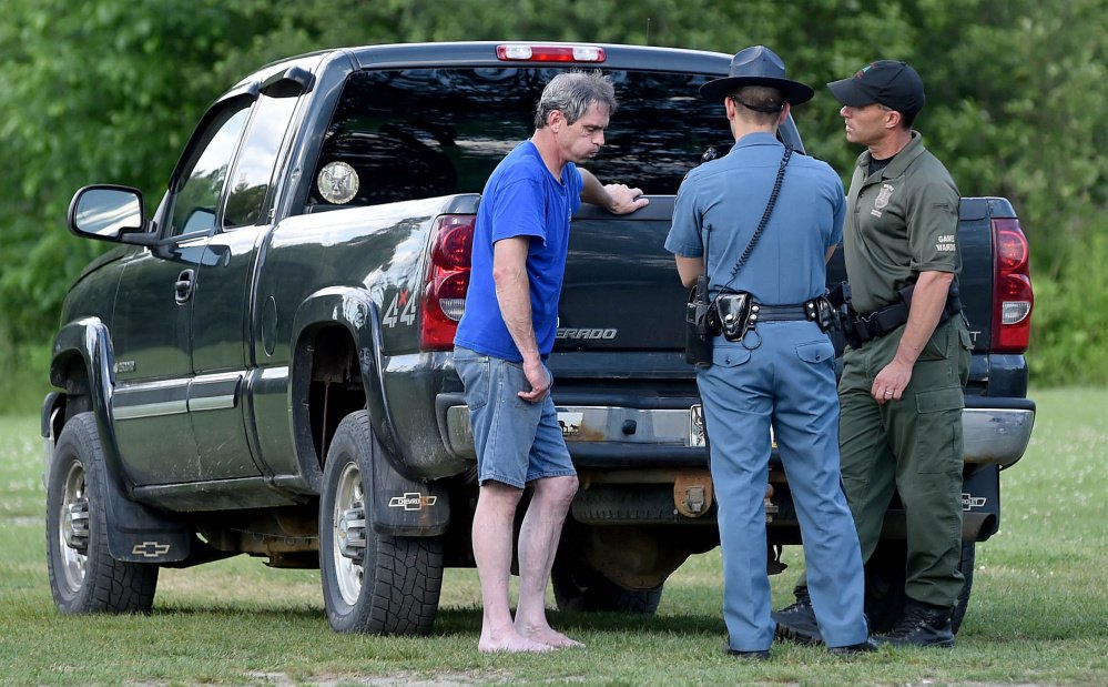 A game warden and a state trooper talk to Jeffrey Smith of Norridgewock, who was ejected from a motorboat on the Kennebec River along with Barbara York of Waterville on Thursday. York drowned, though Smith attempted life-saving efforts on her, according to a news release from the Department of Inland Fisheries and Wildlife.