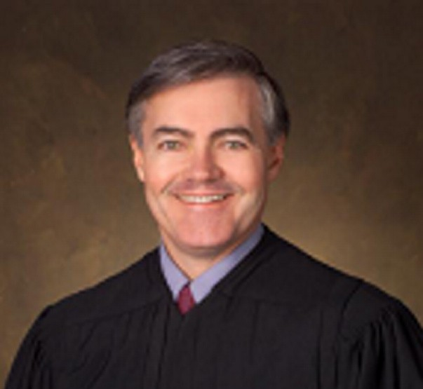 U.S. District Court Judge John A. Woodcock Jr. is moving to senior status, which will create a vacancy on the federal bench in Maine, the court announced Thursday.
