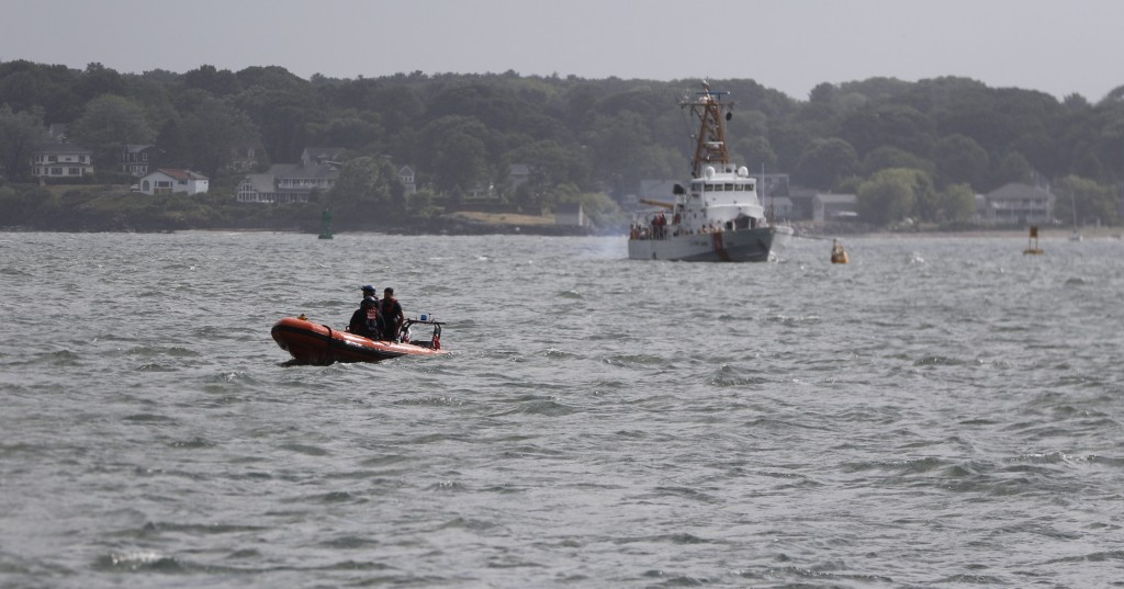 Rescue boats are seen in Casco Bay as emergency crews remove people from a capsized boat on Saturday.