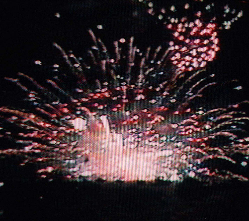 A defective shell explodes on the ground, igniting fireworks yet to be lit on July 5, 1997.