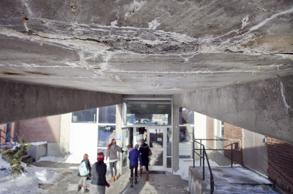 A section of crumbling concrete on the underside of a ramp at the Howard C. Reiche Community School in Portland gives a sense of the amount of deferred maintenance in the city's elementary schools.