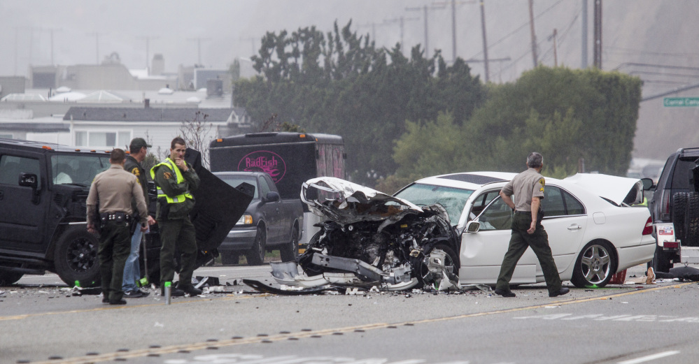 Los Angeles County Sheriff's deputies investigate a fatal crash in Malibu, Calif., in February of last year. U.S. traffic fatalities rose 7.7 percent to 35,200 in 2015, according to the National Highway Traffic Safety Administration.
