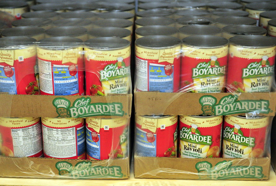 Food sits on the shelves of the new food bank Thursday at the Augusta Boys & Girls Club in the Buker Community Center in Augusta.