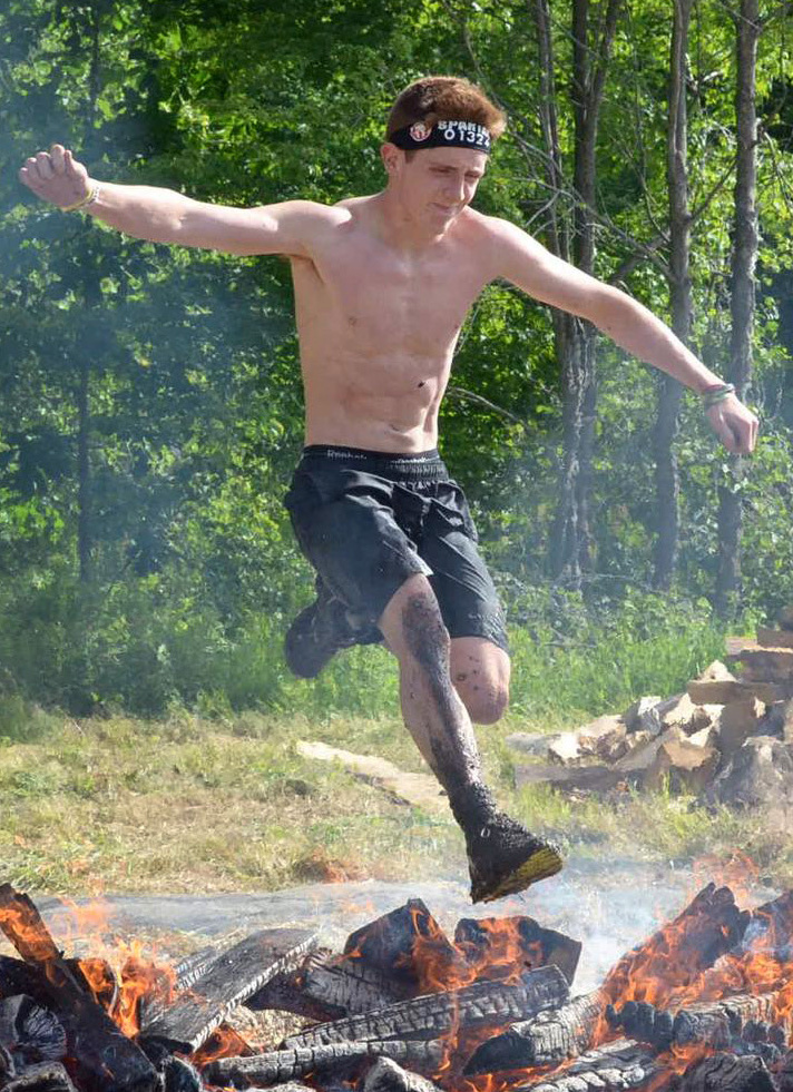 Isaac Douglass, 18, will jump over fire, crawl under barbed wire, and all else needed to compete in a Spartan Race.