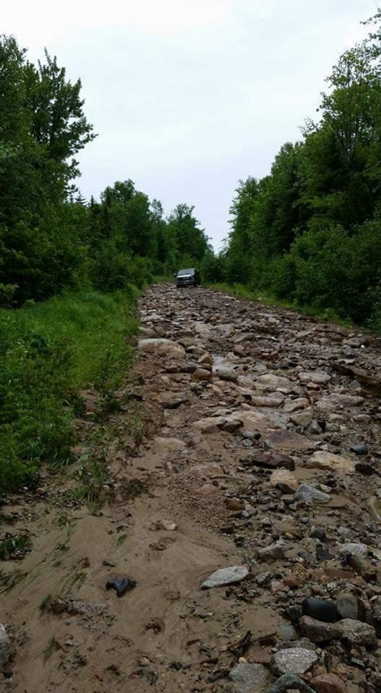 Old Spencer Road in northern Somerset County is washed out and littered with rocks after Tuesday's storm.