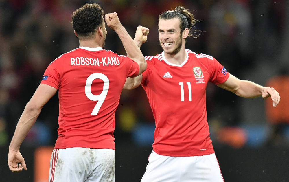 Hal Robson-Kanu, left, and Gareth Bale celebrate Friday after Robson-Kanu scored the second-half goal that gave Wales the lead in what turned into a 3-1 victory against second-ranked Belgium in the European Championship quarterfinals at Lille, France.