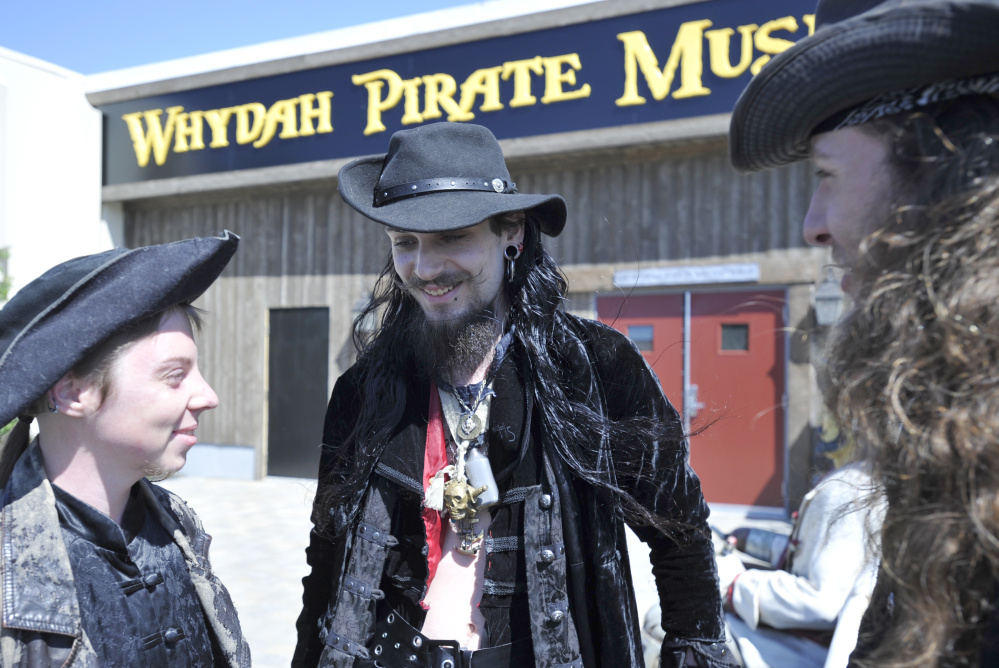 Staff members greet visitors outside the Whydah Pirate Museum during the attraction's grand opening June 25 in West Yarmouth, Mass. The museum is named for a ship called Wydah, which was captained by Black Sam Bellamy.