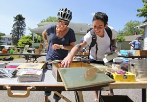 Rachel Wortheimer and Kristen Carbone stop by on their bike ride to shop at a yard sale held by Jim Quatrano in South Portland.