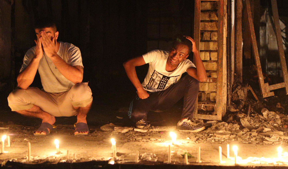 People light candles at the scene of a massive suicide bomb attack in Baghdad on Sunday.