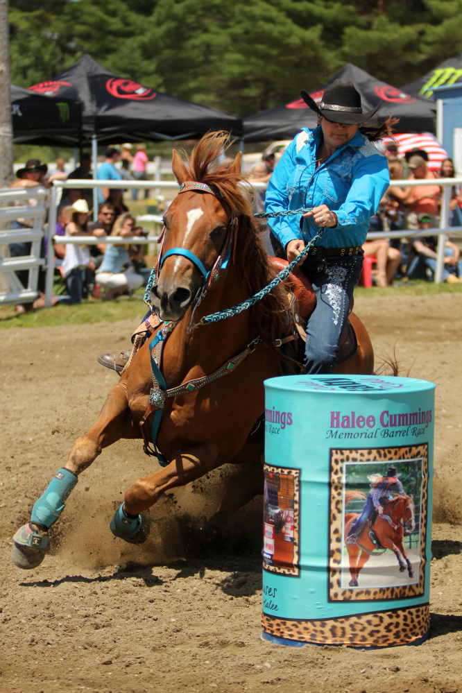Tammie Cyr, of Hermon, rides her horse Roan Hopper at the Halee Lyn Cummings Memorial Barrel Race at the Silver Spur Riding Club in Sidney on Sunday. Halee Cummings, 18, of Sidney, died in an ATV accident last year.