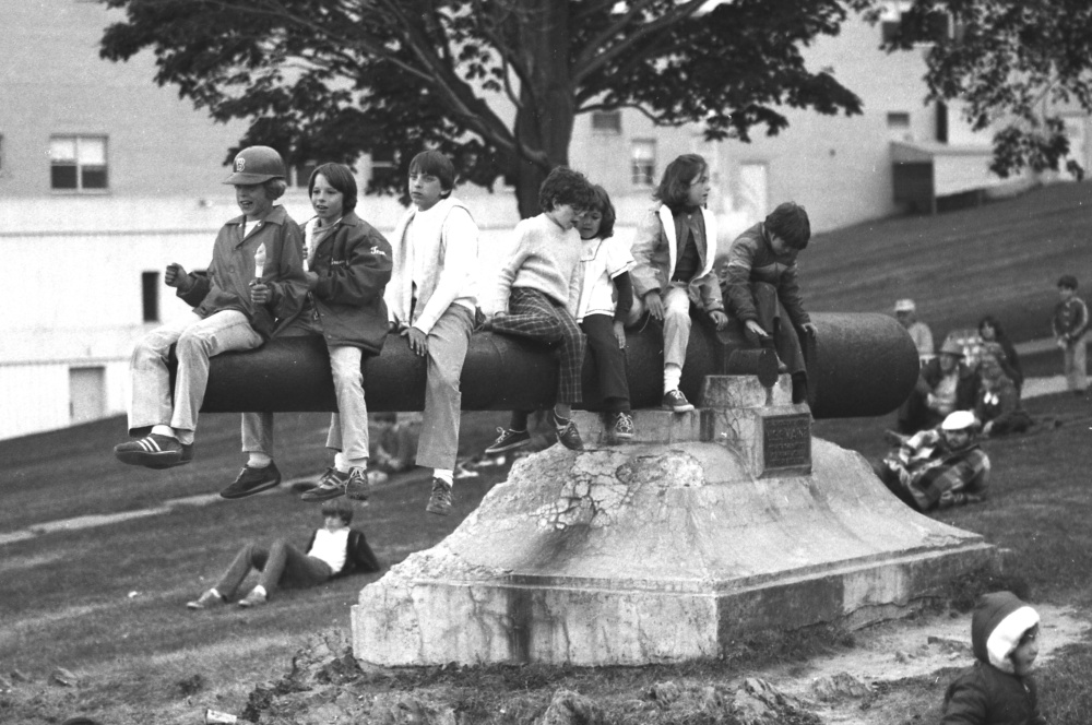 In this photograph from the Portland Evening Express on July 5, 1978, children play on the USS Maine cannon in Fort Allen Park while they wait for the evening's Fourth of July fireworks display.