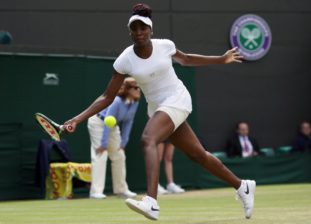 Venus Williams returns to Yaroslava Shvedova of Kazahkstan during their women's singles match at Wimbledon. Williams reached the semifinal round for the first time in seven years by beating Shvedova.