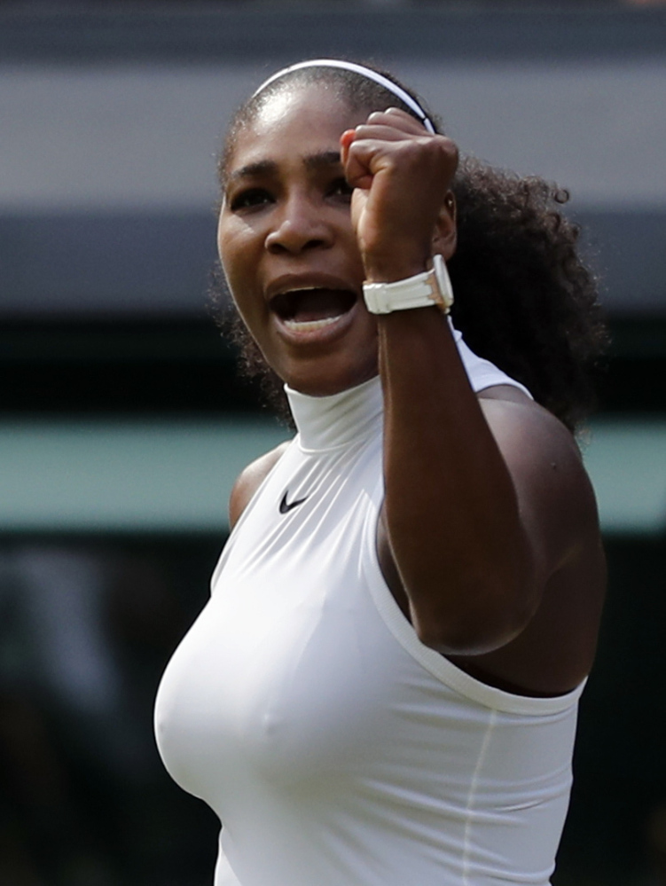 Serena Williams of the U.S celebrates after beating Anastasia Pavlyuchenkova of Russia in a women's singles match on day nine in London.