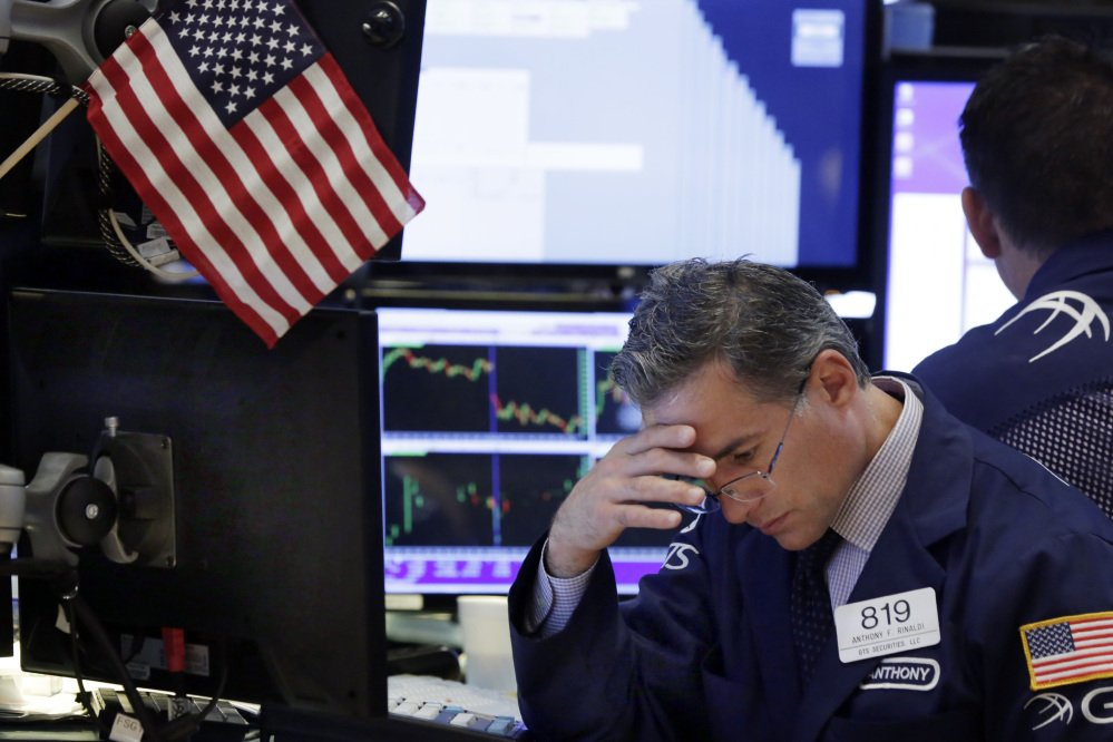 Specialist Anthony Rinaldi works on the floor of the New York Stock Exchange on Tuesday.