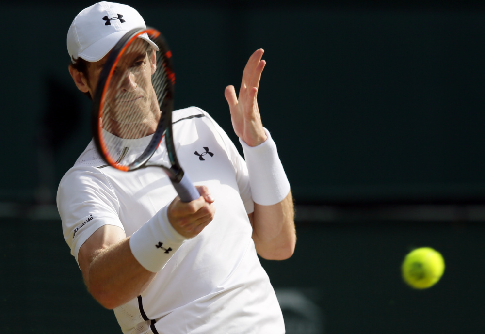 Andy Murray of Britain returns to Jo-Wilfried Tsonga of France during their men's singles match.