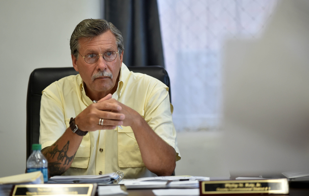 Newell Graff Jr., county commissioner of District 4, listens to a discussion about aid for the private roads destroyed by heavy rain in the unorganized territory in the Commissioner's Chambers at the Somerset County Superior Court House in Skowhegan on Wednesday. Graf said the owners of the private roads should be responsible for repairs.
