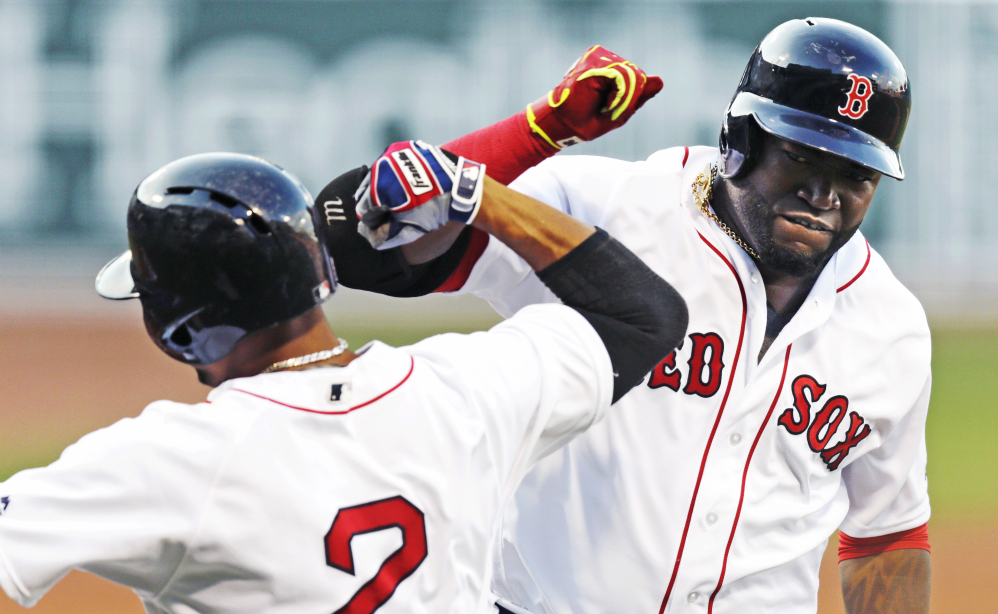 David Ortiz celebrates with Xander Bogaerts after his two-run home run off Texas Rangers starter Martin Perez in the first inning Wednesday night at Fenway Parl. The homer gave Ortiz his 15th straight season with 20 or more home runs.