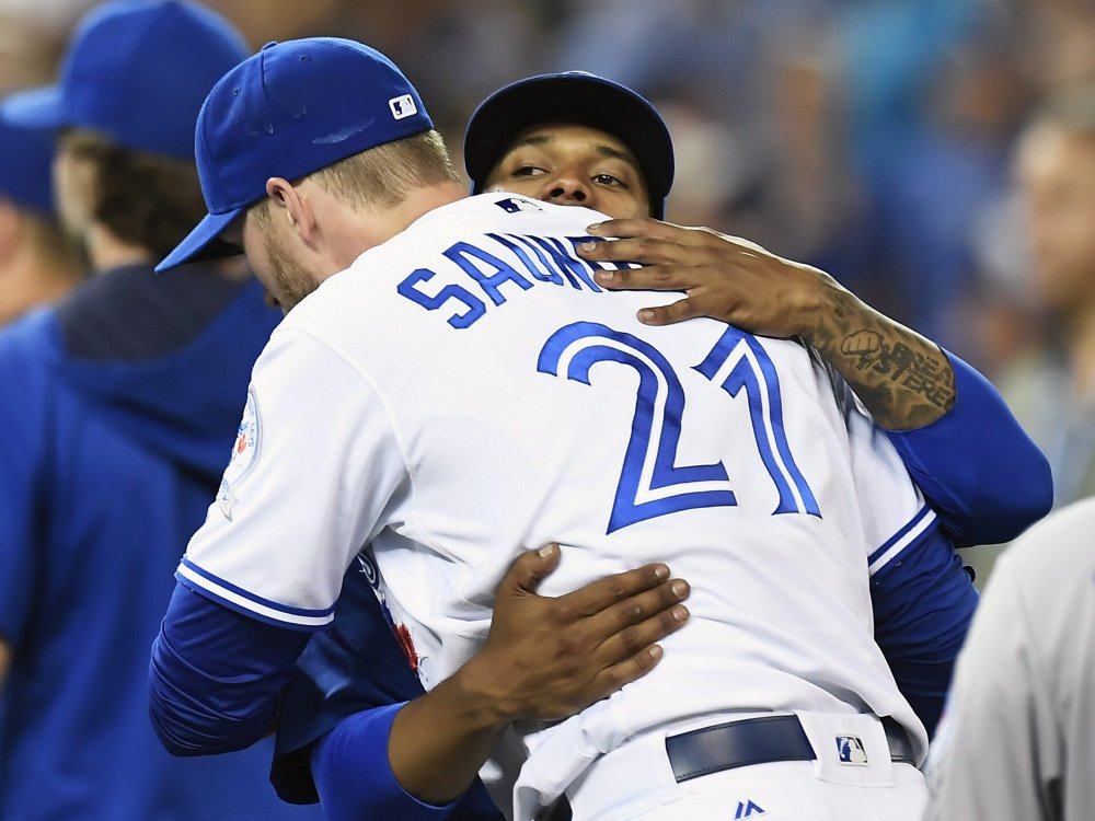 Starting pitcher Marcus Stroman, right, and designated hitter Michael Saunders celebrate the Toronto Blue Jays' 4-2 win over Kansas City on Wednesday.