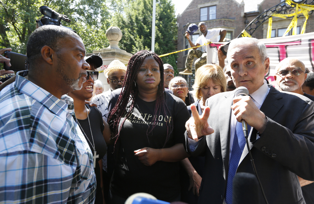 Minnesota Gov. Mark Dayton speaks with Diamond Reynolds, second from left, during a press conference Thursday at his residence regarding the death of Philando Castile. Also at left is Clarence Castile, Castile's uncle, and Nekima Levy-Pounds, center. Dayton called for a federal investigation of the police shooting. Leila Navidi/Star Tribune via AP