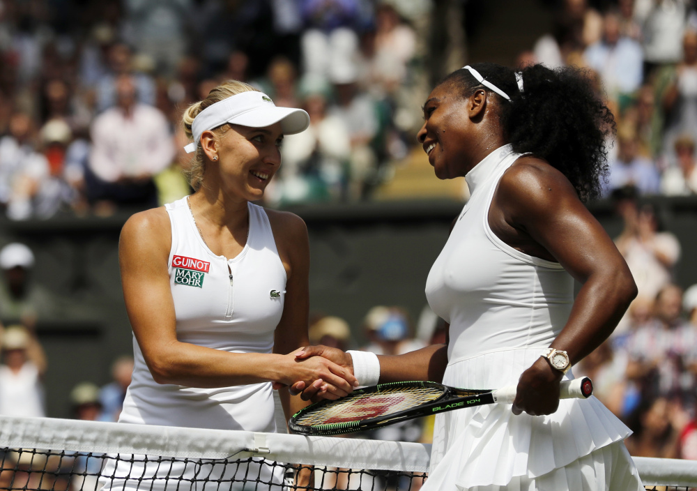 Serena Williams shakes hands with Elena Vesnina of Russia after beating her in their women's singles match at Wimbledon