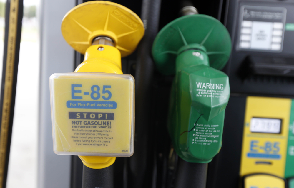 Nozzles for E-85, left, an ethanol fuel blend, and traditional gas are seen at a gas station in Batesville, Miss., in 2014. Ethanol has been a major part of the U.S. energy mix since 1908.