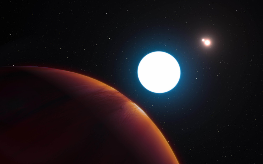 A European Southern Observatory's artist's impression shows planet HD 131399Ab in its triple star system 320 light years away. Astronomers revealed their findings Thursday.
