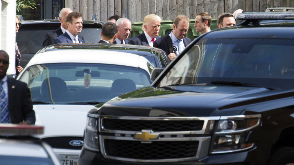 Republican presidential candidate Donald Trump leaves a meeting with Republican House members at the Capitol Hill Club in Washington on Thursday.