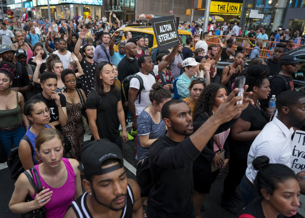 Protesters march in New York's Times Square on Thursday in response to the police shooting deaths of Philando Castile in St. Paul, Minn., and Alton Sterling in Baton Rouge, La.
