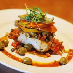 Zapoteca's Veracruzano halibut ($28) is made with green olives, capers, raisins and diced tomato, with thick slices of pickled carrots and jalapeños.