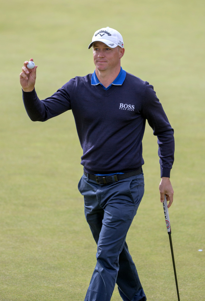 Sweden's Alex Noren acknowledges the fans after his birdie on the eighth hole gave him the lead at the Scottish Open. Noren was at 8-under 136 after shooting a 66.