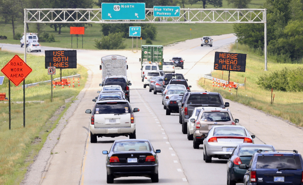 Drivers head into a construction zone in Overland Park, Kan., on Thursday. Kansas and Missouri officials hope to manage heavy construction seasons by encouraging drivers to wait as long as possible before merging during lane closures – and then stagger their flow.