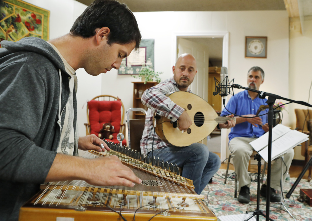 Duncan Hardy, left, Amos Libby and Eric LaPerna mark the end of Ramadan with music during a celebration in Westbrook on Saturday.