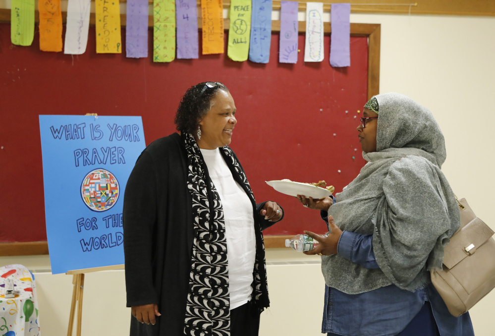 Regina Phillips, left, speaks with Deqa Dhalac at the Eid-al-Fitr celebration Saturday in Westbrook. The event drew several hundred attendees.