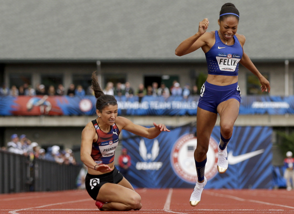 Jenna Prandini, left, dives across the finish line to claim the third spot on the U.S. Olympic team in the 200 meters – .01 second ahead of the 2012 Olympic champion Allyson Felix.