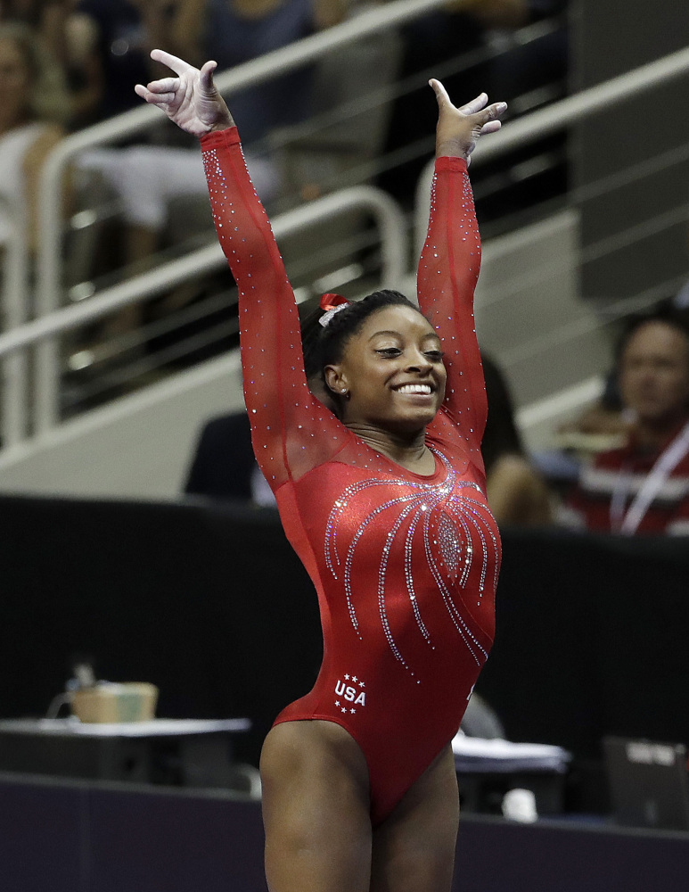 Simone Biles sticks her landing after her vault routine on her way to winning the Olympic gymnastics trials Sunday in San Jose, California.
