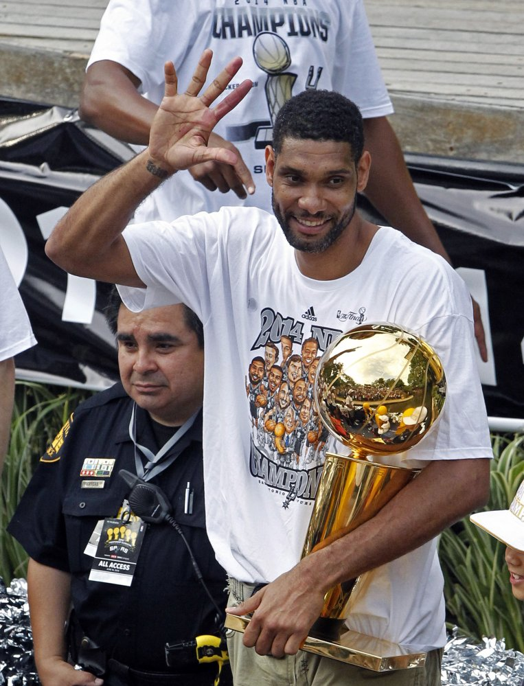 At celebration in June 2014, after San Antonio beat Miami for the championship, Tim Duncan shows fans five fingers representing the five NBA titles his Spurs won. Duncan announced his retirement on Monday after 19 seasons, five championships, two MVP awards and 15 All-Star appearances.