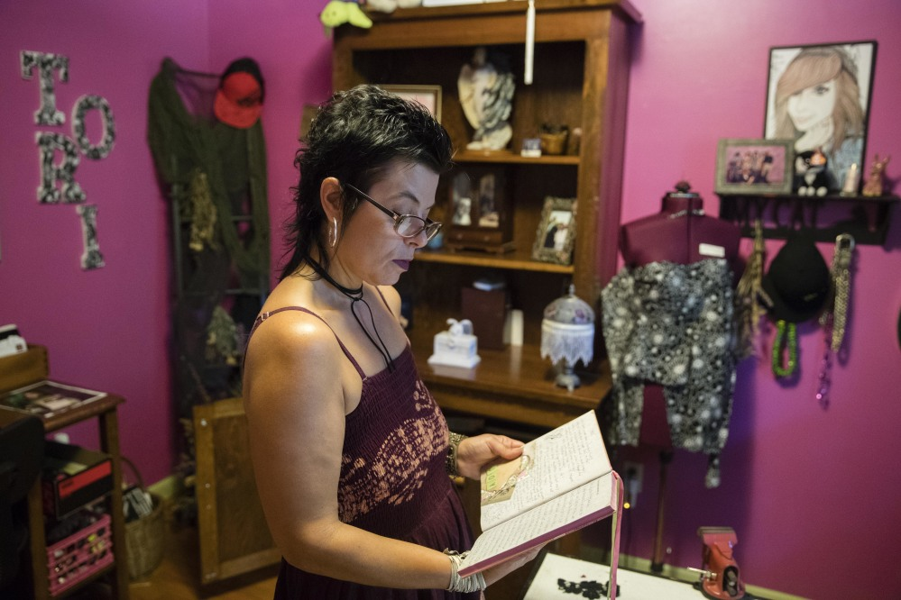 Stephanie Moyer reads her daughter's diary in Lebanon, Pa. Moyer's daughter Victoria