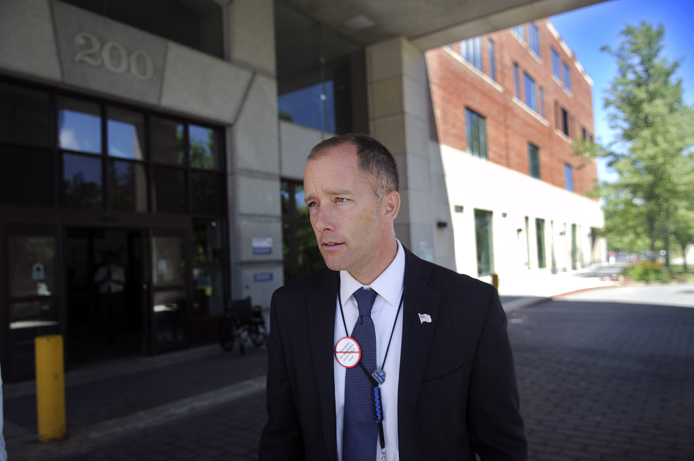 Ryan Lilly, director of the VA Maine Healthcare System hospital at Togus, walks through the hospital Monday during a tour of the facility.